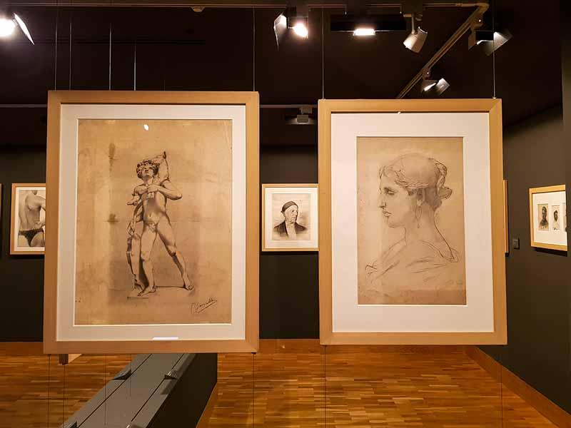 El niño del cordero y retratos de Ceferino Pallás y mujer joven con pendientes